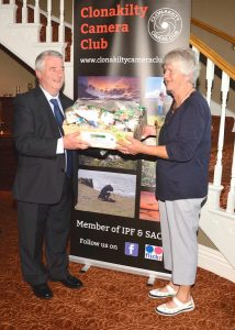 Mary Ann O'Neil from Skibbereen, receiving the first prize hamper from Diarmuid O'Sullivan.