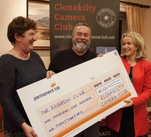 Kathleen Hayes (l) and Nicholas Cooper (c) present Maeve Hurley (r) from the Rainbow Club with a huge cheque!